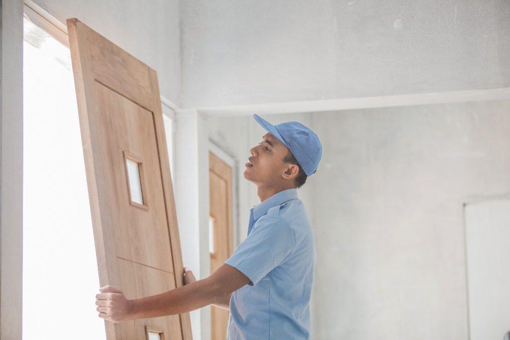 man installing a door