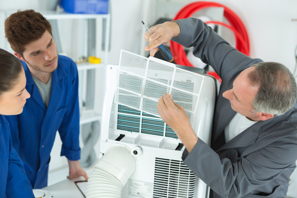 professionals cleaning hvac